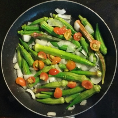 Vegetables in the stir-fry were cherry tomatoes, onions, and whole okra.